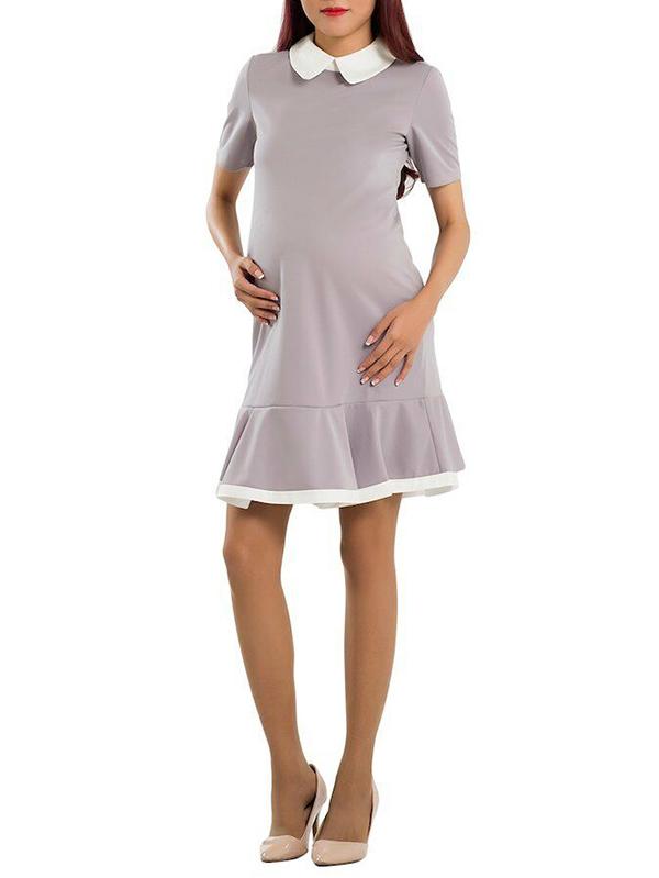 Thiết kế cổ sen cùng chân váy đuôi cá khiến đồng phục bầu thêm phần nữ tính, dịu dàng